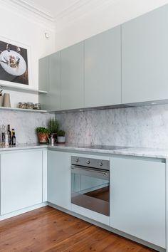 mint green kitchen, countertop matches the backsplash