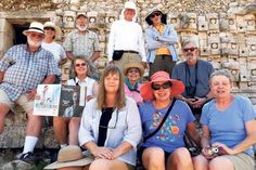 Now Being Read in the Yucatan. Taos Archaeological Society members at a Mayan Temple in the Yucatan take time to display The Taos News TEMPO.