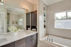 Dark wood accents this all white bathroom to give it a clean, simple style! White Quartz Counter, Espresso Cabinets, All White Bathroom, Soaker Tub, Transitional Bathroom, Wood Accents, Classic House, Corner Bathtub, Home Renovation