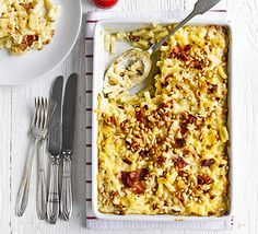 Macaroni cheese with bacon & pine nuts. You don't get much more comforting than a melty pasta bake with a crunchy topping. Serve with a crunchy green salad