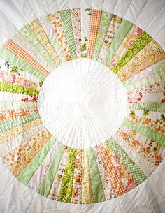 Take an unconventional approach to patchwork quilting with a circular pattern that works perfectly as a wedding quilt pattern. You can use any color scheme to make this patchwork quilt design truly shine.