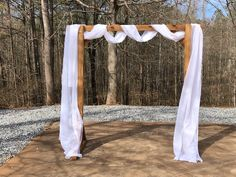 Beautiful arbor for your ceremony!  White tulle included and different style options that we can provide you!
