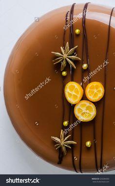 stock-photo-mirror-glaze-mousse-cake-with-anise-and-kumquat-524284303.jpg (993×1600)
