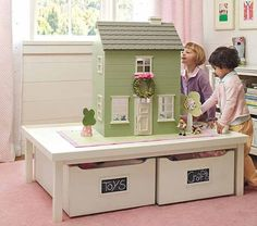 like the idea of the table with boxes under for lego and trains. doll house is neat if i had a girl!