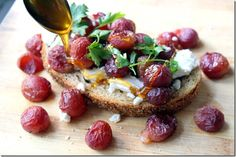 Roasted grapes on toast with goat cheese, honey and fresh herbs