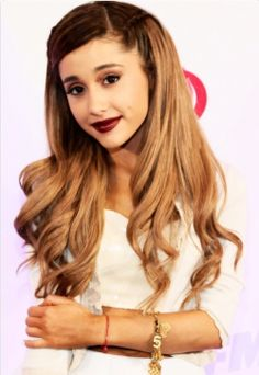 Ariana Grande. Goodness I love her. She only like 20 and she sings like a angel! Wish I could sing like that. One of my all time favorites! Forever jealous