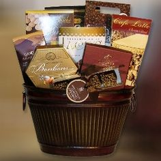 Saxon - Send an elegant token of appreciation! Our Saxon gift basket features a tempting selection of assorted bonbons, Godiva truffles (4 pc), Dark Chocolate almond caramels, Café Latté, mouth watering Chocolate meringues, French Vanilla gourmet coffee, Godiva Dark Chocolate almonds, Bali's Premium Coffee candy and Chocolate Almond toffee wafers.