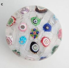 Clichy chequer millefiori glass paperweight with rose cane c.1850
