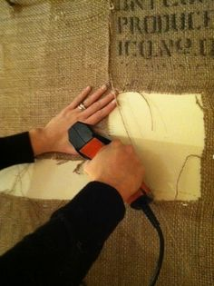 burlap + staple gun = easy way to add texture and hide less than perfect walls. #adodsons #insidetheshop