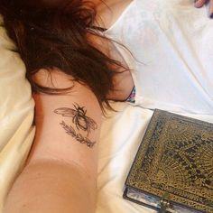 Bee tattoo black ink inner arm