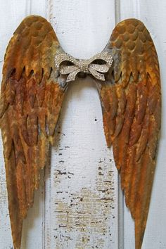 Rusted metal angel wings wall sculpture with rhinestone bow shabby chic…