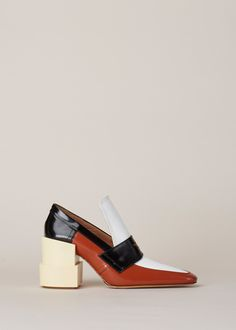"""Heeled loafer in multi-tonal leather. 4.25"""" chunky, layered heel in wrapped leather with a natural sole. Black strap with glitter detail across foot. Concealed elastic gore at the inner arch for fit. Signature white Maison Margiela stitch at back. Branded dust bag included."""
