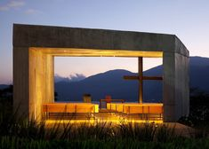 Skewed concrete chapel balances over mountainside, El Salvador, EMC Arquitectura