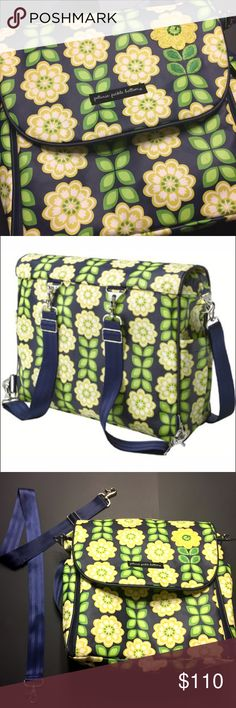 ••Petunia Pickle Bottom••Boxy backpack diaper bag A modern mom's quintessential companion, the Boxy Backpack features a versatile design, lighter weight construction & comes with Stroller Straps. This top-selling diaper bag ensures that every detail is at the ready with a clever built-in changing station ⭐️missing the extension piece ⭐️ organizational pockets & multiple carrying options. This navy with yellow flowers is gorgeous. There is a small nic in the shoulder strap shown in photos…