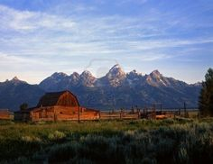 An old ranch and the Teton Mountain Range in Grand Teton National Park, Wyoming.