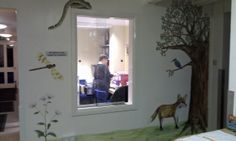 This school decided to show their four houses, fox, kingfisher, grass snake and dragonfly in a mural in their reception area. By Charlotte Designs