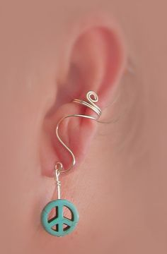Ear cuff with turquoise peace symbol by thelazyleopard on Etsy, $12.00