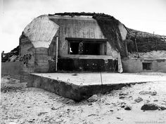 Along the coast of France near Utah Beach is this German strong point, an 88-mm gun emplacement concrete fortification. August 2, 1944