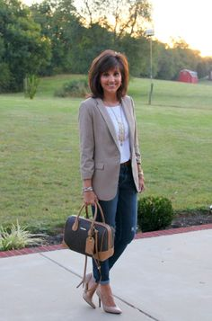 On casual Friday, pair a neutral blazer with cuffed denim and nude pumps.