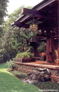Love the hanging pendant, the chunky wood, the way the porch eases into the landscape. The Blacker House Greene Greene