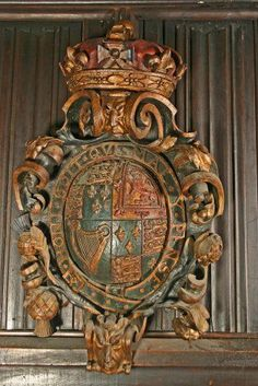 """1558. Elizabethan Armoires or Blazon showing Tudor Kingdom. A fine carved oak coat of arms of Elizabeth I, the shield with in the Order of the Garter motto translated reads: """"Shame on him who thinks evil of it."""" It is still the motto of the Royal family today."""