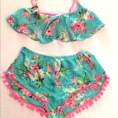 Victoria's Secret Tropical Tap shorts w/ Bra top Never worn, Victoria's Secret tap short and bra top ensemble in Tropical Print. Pink Pom-Pom detailing on these cute, high cut shorts and pink mesh lining on bra top. Set is a size M. Victoria's Secret Intimates & Sleepwear Bras