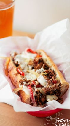 #Vegan Jackfruit Philly Cheesesteaks! Season, charred jackfruit tossed with grilled onions, peppers, and melty daiya cheese on sub rolls.