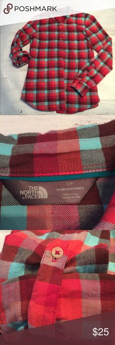 North Face flannel shirt Cozy, 100% cotton, long sleeve, button up shirt.  Sleeves can be worn down or rolled up w/button tab.  Only worn once or twice & in excellent condition.  Vibrant red with aqua checks. North Face Tops Button Down Shirts