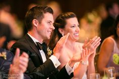 Groom and bride listening to wedding toasts at the Ritz-Carlton Reynolds Plantation