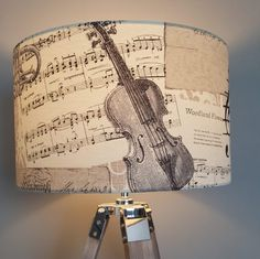A modern lampshade, handmade and created using stunning music theme fabric in natural tones. This is a large drum lampshade. Handmade Lampshades, Modern Lamp Shades, Drum, Music, Fabric, Natural, Projects, Musica, Tejido