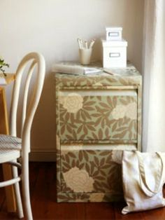 Refurbish a Filing Cabinet. I'm definitely going to find some funky wallpaper!