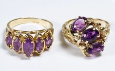 Lot 269: 10k Gold and Amethyst Rings; Two rings, one having (3) oval cut amethyst, the other having (5) graduated marquis cut amethyst