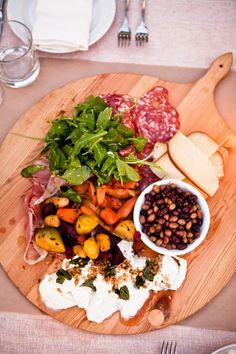 Wild olives, sopressa salami, golden and purple heirloom carrots, lemon dressed rocket, and torn burrata