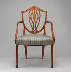A Pair of armchairs Date: ca. 1780–85 Culture: British Medium: Satinwood, modern silk