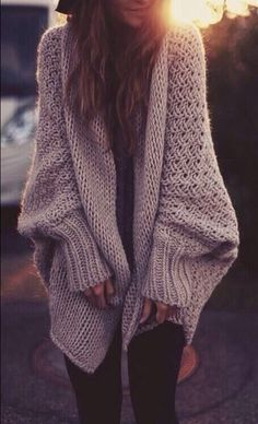 Oversized cozy knits look best originally with leggings and boots. But to spice it up a little, why not wear rolled up denim with some boat shoes for that indie/boho chic look?