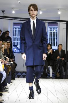 Hussein Chalayan, however, new to the menswear schedule and hosting an intimate salon-style presentation, was one designer who managed to get the balance right. His precision cuts came with just th...