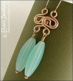 Bronze swirl link earrings with aquamarine coloured torpedo beads #wirejewelry