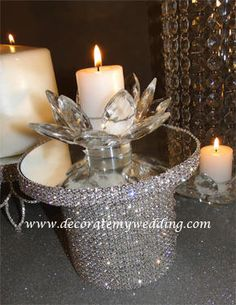 """MINI RHINESTONE STAND  This mini rhinestone stand adds loads of sparkle to your table.  You can can use if for candles, flowers, or anything you wish.  4 1/2"""" high, 4"""" diameter.  Mirrored top."""