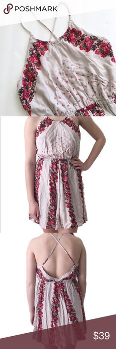 Free People Dress Free People floral dress. Straps cross in the back. In very good condition.   ⭐️10% off 2+ bundle  ⭐️Size Small ⭐️Smoke free home  ⭐️No stains or flaws Free People Dresses Mini
