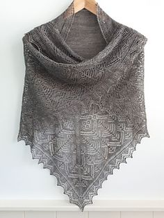 This triangular Shetland Lace shawl is knitted all in one piece and incorporates a garter stitch centre, borders of rose trellis and tree motifs and is finished with simple lace edgings.