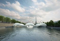 designboom inflatable bridge equipped with giant trampolines dedicated to the joyful release from gravity as one bounces above the Seine River
