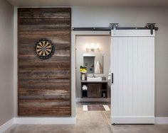 How nice would the timber look for the fireplace then the white barn door to the hallway!