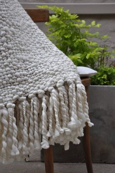 This Alma chunky cable knit throw blanket is a super chic master piece.Almost a must piece, if you want to decor your house as a trendy & chic home.Volumes of chunky superfine merino wool yarn have been loosely hand woven together intotwistedtight chunky knots. Finished with extra long hand knotted fringes - this really is a forever piece finished to ensure the highest quality, softness and comfort.  This finished 'Alma Throw Blanket' is the squishiest, most comfy throw you've eve...