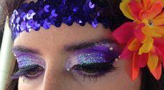 Purple sparkly rave makeup.