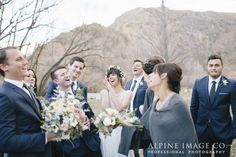Love these candid moments at weddings! Photography by Alpine Image Company