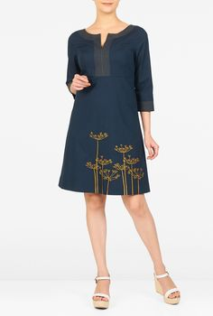 Striking trapunto detailing and dandelion embellishment define our cotton poplin shift dress fitted at the empire waist for a flattering silhouette.