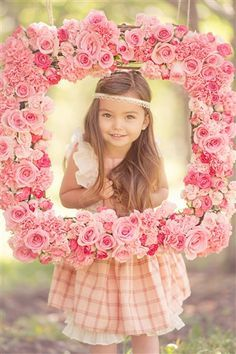 Adorable photo session for young girl..inside of a flower frame how cute and easy to diy one of these. #Persnickety Clothing -  Hopscotch Dress Multi