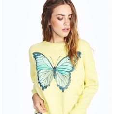 Blue Butterfly Sloan Sweat NWT Wildfox flight like a beautiful butterfly in our Sloan Sweater. Cozy and comfy pullover sweatshirt in a light fleece blend with vintage detailing. In Pina Colada Yellow.  70% Cotton, 30% Polyester Wildfox Sweaters