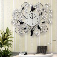 Unique wall clocks make excellent pieces of home wall art décor.  In fact, the right large wall clock can truly  elevate any room of your home.  Indeed,  this one is truly timeless and one of a kind.   Truly charming, sophisticated and one of the best decorative wall clocks  to use when sprucing up your home.  I  love the popular style and design of this wall decoration.      Large diamond luxury modern living room wall clock watch European