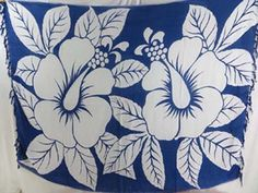 white giant hibiscus flower sarong hawaiian pareau with assorted color backgrounds - http://www.wholesalesarong.com/blog/white-giant-hibiscus-flower-sarong-hawaiian-pareau-with-assorted-color-backgrounds/